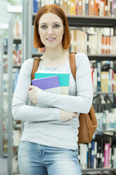 Portrait of a student in a university library - WESTF019735
