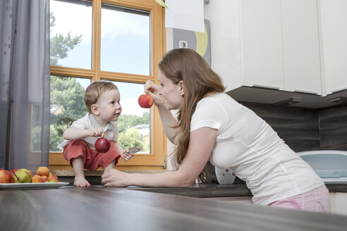 Mother with baby boy in kitchen - VTF000326