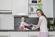 Mother with baby boy in kitchen - VTF000332