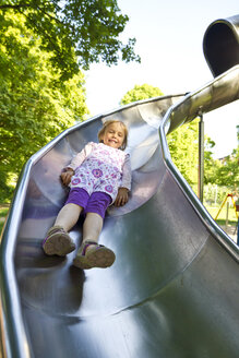 Little girl sliding on shute - JFEF000412