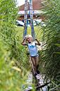 Little girl balancing at climbing crag - JFE000428
