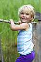 Little girl balancing on a wooden raft - JFEF000458