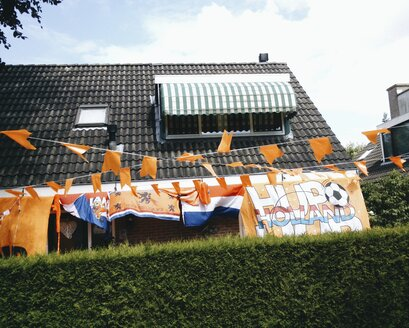 The Netherlands, Flevoland, Almere, House decorated with orange and Dutch flags during the soccer wold championship, - HAWF000346