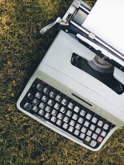 Vintage portable mechanical typewriter outside on a a lawn, - HAWF000348