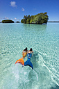 Palau, two young women in mermaid costume swimming in a lagoon - JWAF000105