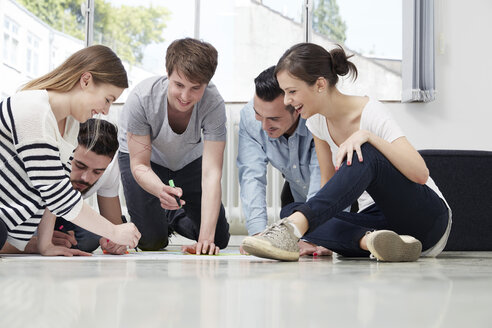 Group of creative professionals working on floor - STKF000931