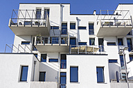 Germany, Hesse, Frankfurt Riedberg, view to modern multi-family house with balconies, partial view - JWAF000122