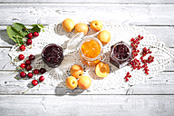 Cherry jam and cherries, Apricot jam and apricots, Currant jam and red currants on dolly - MAEF008583