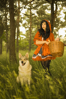 Red Riding Hood standing besides the wolf - FCF000276