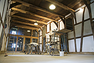 Germany, North Rhine-Westphalia, renovating walls in a hall of a half-timbered house farm house - HAW000387