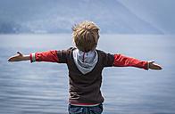 Italy, Lombardy, Province Como, Menaggio, Young boy at Lake Como - PAF000731