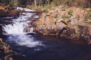 Australia, Litchfield National Park, Woman relaxing at Buley Rockhole - MBEF001071