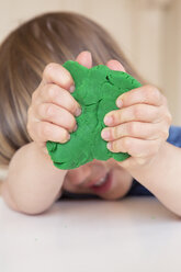 Girl playing with modeling clay - LVF001518