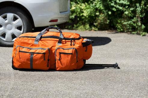 Germany, Bavaria, Wheeled luggage on floor - MAEF008672