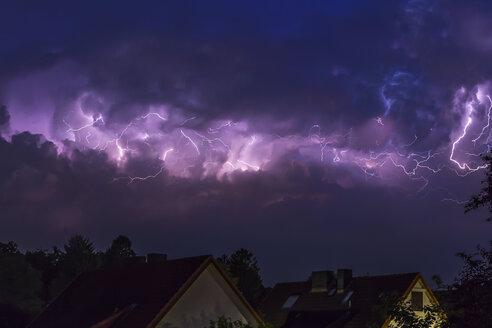 Germany, Hamburg, dramatic night sky at heavy thunderstorm - NKF000168