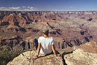 USA, Arizona, man enjoying the view at Grand Canyon, back view - MBEF001100
