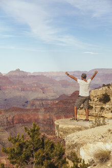 USA, Arizona, man enjoying the view at Grand Canyon, back view - MBEF001086