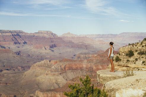 USA, Arizona, woman enjoying the view at Grand Canyon, back view - MBEF001089