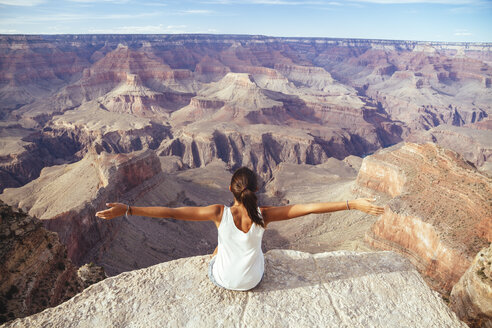 USA, Arizona, young woman enjoying the view at Grand Canyon, back view - MBEF001092