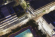 Thailand, Bangkok, aerial view of the streets and swimming pool at night - MBEF001095