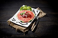 Watermelon with ham and basil on plate - MAEF008684