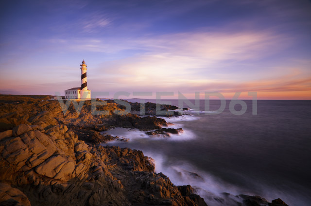 Spain, Balearic Islands, Menorca, Cap de Cavalleria, lighthouse at sunrise - SMA000219