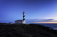 Spain, Balearic Islands, Menorca, Cap de Cavalleria, lighthouse at sunrise - SMAF000220