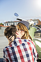 Teenage couple kissing outdoors - FKF000590