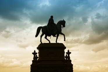 Germany, Saxony, Dresden, view to Equestrian statue of King John in front of cloudy sky - EL001146