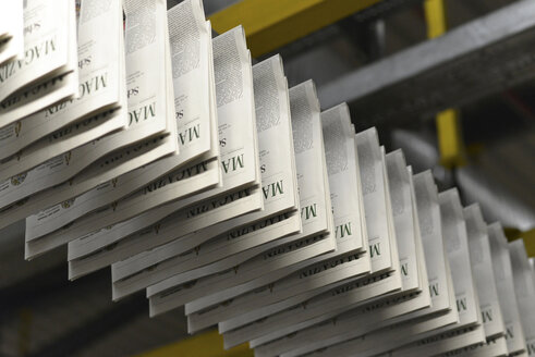 Conveyor belt with printed newspapers in a printing shop - SCH000345