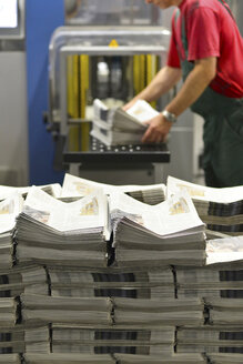 Employee in a printing shop preparing shipment - SCH000348