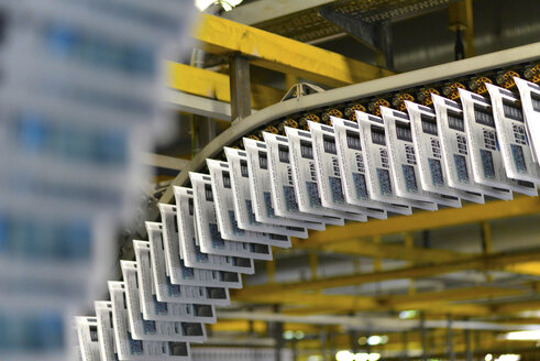 Conveyor belt with printed newspapers in a printing shop - SCH000353