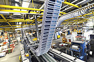 Conveyor belt with brochures in a printing shop - SCH000354