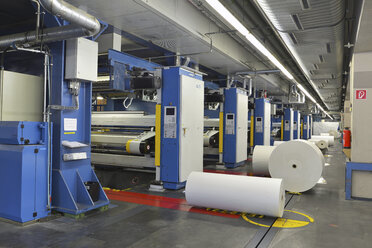 Presses with rolls of paper in a printing shop - SCH000358