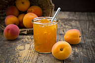 Glass of apricots jam and apricots on wood - LVF001538