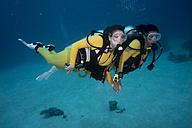 Palau, Pacific Ocean, two scuba divers in coral reef - JWAF000156