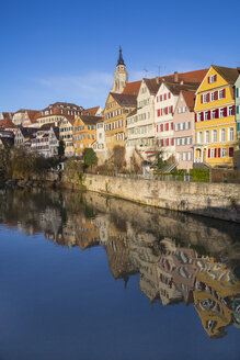 Germany, Baden-Wuerttemberg, Tuebingen, Row of houses, Neckar river, Collegiate church in the background - LVF001567
