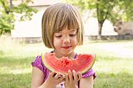 Portrait of little girl with slice of watermelon - LVF001571