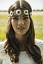 Portrait of young woman wearing floral wreath - UUF001236