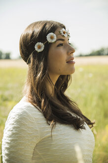 Portrait of young woman wearing floral wreath - UUF001238