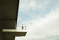 Young woman standing on viewing platform - UUF001356