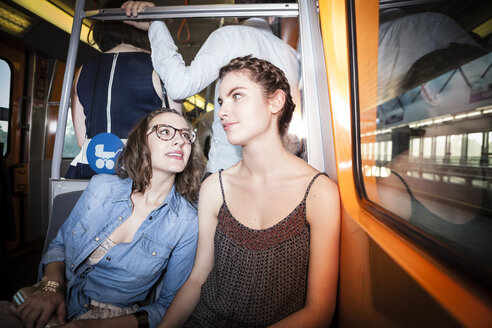 Two young women in a subway - DISF000877