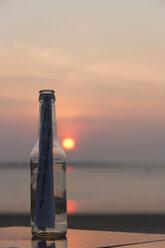 Germany, Bremen, Bremerhaven, Message in a bottle, Sunset - SJ000116