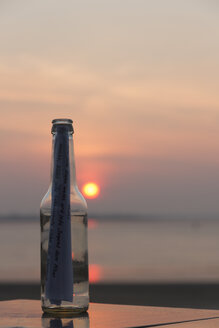 Germany, Bremen, Bremerhaven, Message in a bottle, Sunset - SJ000116