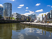Germany, Hamburg, HafenCity, Magellan-Terrassen, Sandtorhafen, Modern residential and office buildings, Elbe Philharmonic Hall in the background - AM002536