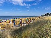 Germany, Schleswig-Holstein, Scharbeutz, beach chairs on beach - AMF002507