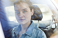 Portrait of young woman on back seat of a car - FEXF000120