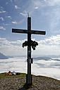 Austria, Tyrol, Chiemgau Alps, Summit cross at Fellhorn mountain - LBF000851