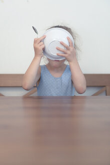 Germany, Young girl eating up - MW000064