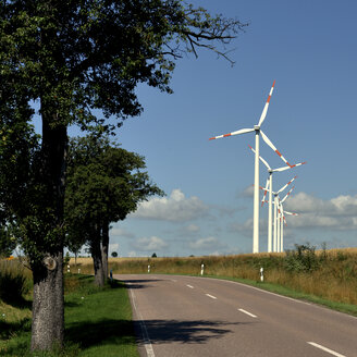 Germany, Saxony-Anhalt, Onshore wind farm on a road - LYF000181